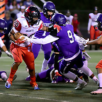 Photo: Jeffery Jones:<br />  Grants Pirate running back Isaiah Johnson (20) eludes a tackle by Miyamura Patriot Aven Begay (9) during Friday night's game at Angelo DiPaulo Memorial Stadium in Gallup.