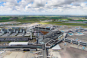 Nederland, Noord-Holland, Schiphol, 28-04-2017; Stationsgebouw en verkeerstoren met vluchtleiding omgeven door hotels en diverse kantoorgebouwen geexploiteerd door Schiphol vastgoed (Schiphol Real Estate). Aan de gates geparkeerde vliegtuigen van onder andere KLM. Schiphol Airport. <br /> Terminal building and control tower surrounded by hotels and office buildings operated by Schiphol Real Estate (SRE). <br /> luchtfoto (toeslag op standaard tarieven);<br /> aerial photo (additional fee required);<br /> copyright foto/photo Siebe Swart
