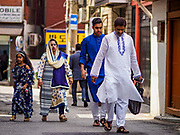 15 JUNE 2018 - SEOUL, SOUTH KOREA:  A Muslim family walks home after Eid services at Seoul Central Mosque on Eid al Fitr, the Muslim Holy Day that marks the end of the Holy Month of Ramadan. There are fewer than 100,000 Korean Muslims, but there is a large community of Muslim immigrants in South Korea, most in Seoul. Thousands of people attend Eid services at Seoul Central Mosque, the largest mosque in South Korea.      PHOTO BY JACK KURTZ