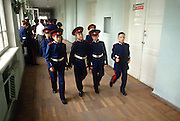 Young Russian Don Cossacks in traditional Cossack uniform walk through the halls of their school on the way to class at the Don Cossack Military School in Novocherkassk, Russia.