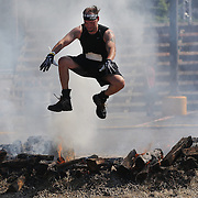 Richard Doody in action at the fire jump obstacle during the Reebok Spartan Race. Mohegan Sun, Uncasville, Connecticut, USA. 28th June 2014. Photo Tim Clayton