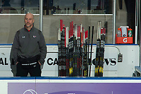 KELOWNA, CANADA - MARCH 3:  Portland Winterhawks' athletic therapist Rich Campbell stands on the bench during warm up against the Portland Winterhawks on March 3, 2019 at Prospera Place in Kelowna, British Columbia, Canada.  (Photo by Marissa Baecker/Shoot the Breeze)