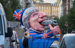 © Licensed to London News Pictures. 09/05/2017. London, UK. An effigy of Prime Minister Theresa May is seen driving past BBC Broadcasting House as she and her husband Philip appear on the One Show. Mr and Mrs May are appearing together on the prime time show ahead of various appearances by all party leaders on TV in the run up to the general election on June 8, 2017. Photo credit: Peter Macdiarmid/LNP