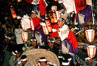 """Japan, Saitama, 1999. Three days of joyous winter celebrations culminate in the drawing of huge floats, or """"yatai,"""" through the streets."""