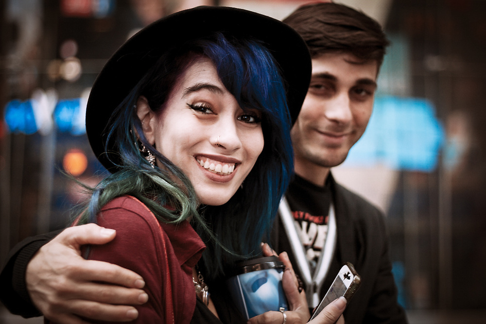 Colored street portrait of cute rocker couple smiling for me. NYC 2016