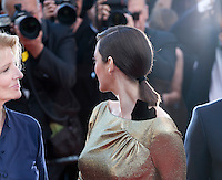 Actress Marion Cotillard turns towards photographers beside Nicole Garcia at the gala screening for the film Mal De Pierres (From the Land of the Moon) at the 69th Cannes Film Festival, Sunday 15th May 2016, Cannes, France. Photography: Doreen Kennedy