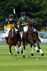 File photo dated 20/7/2003 of Prince Harry (left) on the Eastington team and his elder brother William playing for Tickhill team race each other for the ball at Cirencester Polo Park in Gloucestershire.