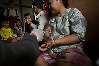 """Rescue"" of a five month old male baby orangutan from captivity in Sungai Besar village by the BKSDA (Department of Wildlife and Nature Conservation) staff and wildlife veteranarian Dr. Ayu from International Animal Rescue."