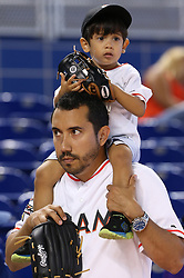 June 4, 2017 - Miami, FL, USA - Ethan Borges, 3, gets a boost from his father Marcel to see the Miami Marlins host the Arizona Diamondbacks on Sunday, June 4, 2017 at Marlins Park in Miami, Fla. (Credit Image: © Patrick Farrell/TNS via ZUMA Wire)