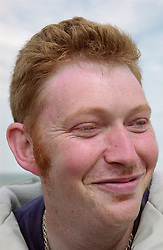Portrait of man with learning disability smiling,