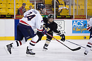 October 13, 2007 - Anchorage, Alaska:  Dave Cowan (24) of the Robert Morris Colonials tries to beat Tylor Michel (16) of the Wayne State Warriors to the puck in RMU's 4-1 victory over the Warriors in the 3rd game of the Nye Frontier Classic at the Sullivan Arena.  RMU would go on to be the Classic Champions after host Alaska-Anchorage tied with Boston University in the 4th game of the Classic.