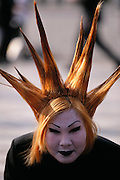 JAP_03_xs.A teenage girl with yellow spiked hair and white face at Harajuku.  Tokyo, Japan. .