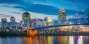 Cincinnati is the third largest city in Ohio and the 28th largest city in the United States by metropolitan population and the county seat of Hamilton County, Ohio, United States. Settled in 1788, the city is located on the border between Ohio and Kentucky at the confluence of the Ohio River and the Licking River. According to the 2010 census, the population of the metropolitan area was 2,214,954 - the 28th largest Metropolitan Statistical Area (MSA) in the United States and the largest based in Ohio. Residents of Cincinnati are called Cincinnatians.<br /> <br /> In the early 19th century, Cincinnati was an American boomtown in the heart of the country to rival the larger coastal cities in size and wealth. Because it is the first major American city founded after the American Revolution as well as the first major inland city in the country, Cincinnati is sometimes thought of as the first purely American city. It developed initially without as much European immigration or influence that was taking place at the same time in eastern cities. However, by the end of the 19th century, with the shift from steamboats to railroads, Cincinnati's growth had slowed considerably and the city became surpassed in population by other inland cities, Chicago and St. Louis.<br /> <br /> Cincinnati is home to two major sports teams, the Cincinnati Reds and the Cincinnati Bengals, an important tennis tournament, the Cincinnati Masters, and home to large events such as the Flying Pig Marathon, the Macy's Music Festival, and the WEBN Labor Day Fireworks/Riverfest. The University of Cincinnati traces its foundation to the Medical College of Ohio, which was founded in 1819.[