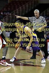09 January 2007: Brooks McKowen dribbles, Referee Rom Eades keeps time.  The Illinois State Redbirds, winless in the Missouri Valley Conference, knocked off the undefeated  Panthers of Northern Iowa 67-64 in overtime at Redbird Arena in Normal Illinois on the campus of Illinois State University.