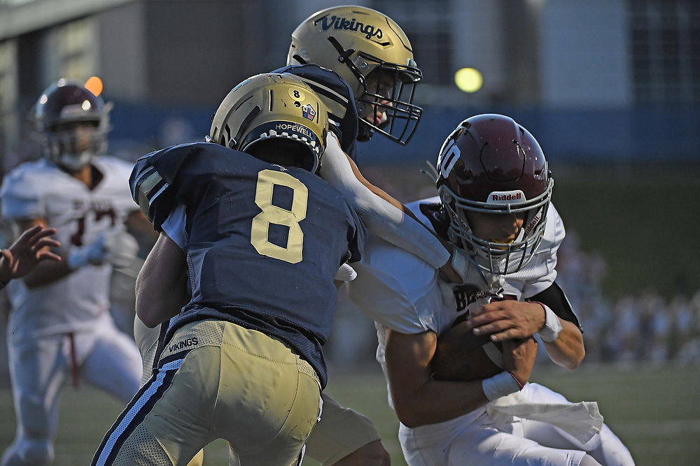 Isaac Pupi #10 of the Beaver Bobcats dives to the endzone for a touchdown as Cameron Fedorka #8 of the Hopewell Vikings defends in the first half during the game at Tony Dorsett Stadium on September 10, 2021 in Hopewell Township, Pennsylvania