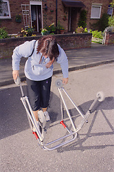 Teenage girl with physical disability collapsing walking frame,