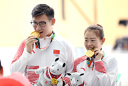 PALEMBANG, Aug. 19, 2018  Wu Jiayu (L)/Ji Xiaojing of China pose for pictures after winning the 10m Air Pistol Mixed Team gold medal at the 18th Asian Games in Palembang, Indonesia Aug. 19, 2018. (Credit Image: © Cheng Min/Xinhua via ZUMA Wire)