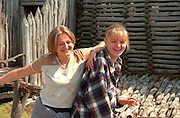 Sisters ages 20 and 17 enjoying reconstructed wall and fence. Ancient Slavic Settlement Biskupin Poland