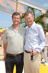 Left to right, JACK KIDD and his father JOHNNY KIDD at the Veuve Clicquot Gold Cup, Cowdray Park, Midhurst, West Sussex on 21st July 2013.
