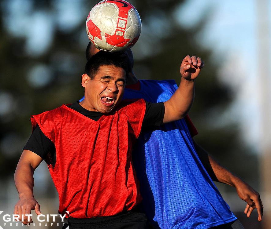 Marco Ecute, with 1st SFG, battles Folarin Durosawo, HHC, 1-364, in the Men's Soccer Championship game May 6 at Cowan Stadium. 1st SFG won 4-1.