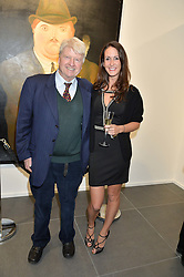 STANLEY JOHNSON and ALEX PAKENHAM at a private view of works by Fernando Botero held at the Opera Gallery London, 134 New Bond Street, London on 10th February 2015.