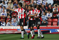 Photo: Lee Earle.<br /> Southampton v Queens Park Rangers. Coca Cola Championship. 30/09/2006. Jermaine Wright (C) is congratulated after scoring their opening goal.