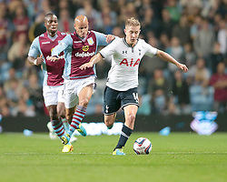 Tottenham Hotspurs' Lewis Holtby and Aston Villa's Karim El Ahmadi challenge for the ball  - Photo mandatory by-line: Nigel Pitts-Drake/JMP - Tel: Mobile: 07966 386802 24/09/2013 - SPORT - FOOTBALL -  Villa Park - Birmingham - Aston Villa v Tottenham Hotspur - Round 3 - Capital One Cup