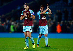 Burnley's James Tarkowski (left) and Chris Wood thank the travelling fans after the Carabao Cup, Second Round match at Ewood Park, Blackburn.