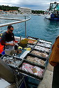 Selling the day's catch directly from the boat, Makarska, Croatia