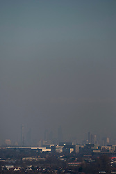 """© Licensed to London News Pictures. 19/01/2017. London, UK. A thick layer of """"toxic"""" smog is seen hanging over central London, blown in from continental Europe, as seen from Northala Fields in west London.  Following the announcement by the Mayor of London of higher than normal pollution levels, Londoners have been urged to protect their health. Photo credit : Stephen Chung/LNP"""