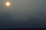 HAZE POLLUTION, Malaysia. Pollution haze caused by burning forests, Ipoh State, West Malaysia. The burning of forests across Indonesia and Malaysia often causes severe pollution and haze. It depends on the amount of burning and the direction of the wind.
