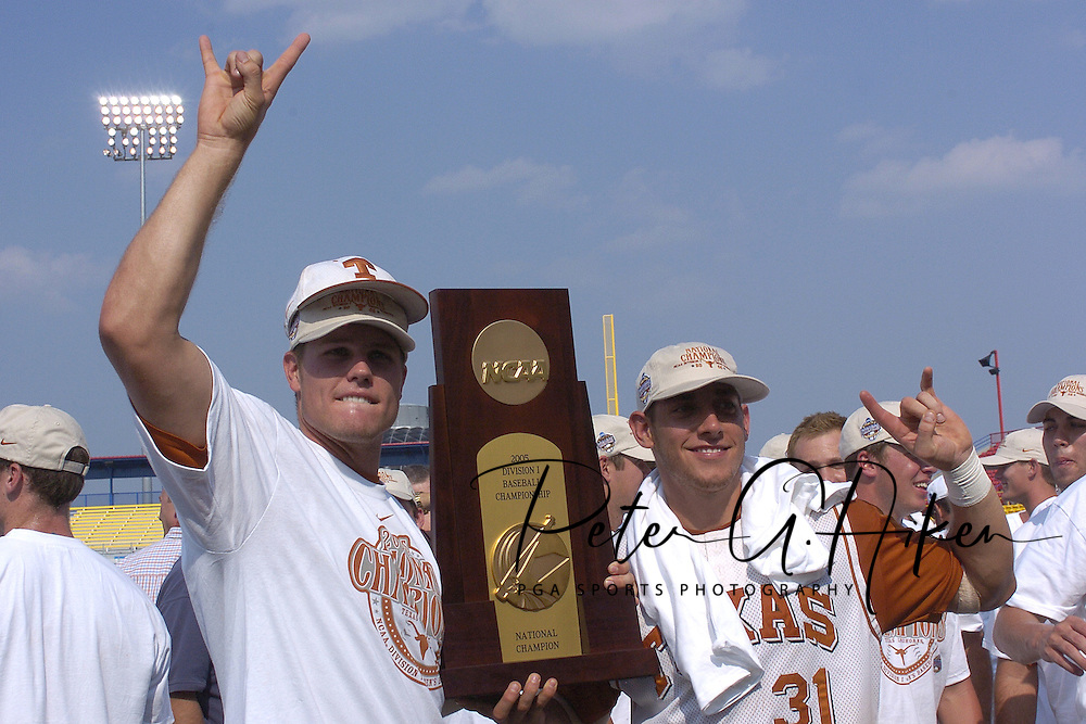 Texas Longhorns Will Crouch (L) and Taylor Teagarden (R) hold the National Championship Trophy after defeating Florida.  Texas defeated Florida 6-2 for the National Championship at the College World Series at Rosenblatt Stadium in Omaha, Nebraska on June 26, 2005.