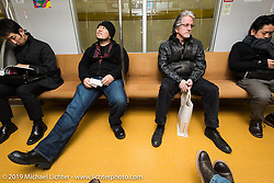 Harley-Davidson's head of design Ray Drea (R) and Dais Nagao on a Tokyo subway. Japan. Wednesday, December 10, 2014. Photograph ©2014 Michael Lichter.