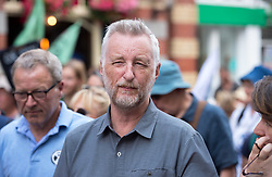 © Licensed to London News Pictures. 16/07/2019; Bristol, UK. Extinction Rebellion Summer Uprising 2019. BILLY BRAGG attends the Extinction Rebellion week of action in Bristol. Billy gave a speech by the pink boat on Bristol Bridge and then marched with campaigners to the Youth XR gathering on College Green in front of City Hall where he sang some songs. Extinction Rebellion are holding a five-day 'occupation' of Bristol, by occupying Bristol Bridge in the city centre and traffic has to be diverted and carrying out other events. As part of a country-wide rebellion called Summer Uprising, followers will be holding protests in five cities across the UK including Bristol on the theme of water and rising sea levels, which is the group's focus for the South West. The campaign wants the Government to change its recently-set target for zero carbon emissions from 2050 to 2025.<br /> In Bristol Extinction Rebellion plan a week-long occupation of Bristol Bridge in the city centre from Monday and organisers anticipate more than 1,000 people will take part in the action. On Tuesday, they will occupy College Green in front of the city's council house before protesting outside the Ministry of Defence in Stoke Gifford on Friday Photo credit: Simon Chapman/LNP.