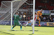 Sean Rigg of Newport county ® has an attempt on goal saved by Russell Griffiths, the Cheltenham goalkeeper.  EFL Skybet football league two match, Newport county v Cheltenham Town at Rodney Parade in Newport, South Wales on Saturday 10th September 2016.<br /> pic by Andrew Orchard, Andrew Orchard sports photography.