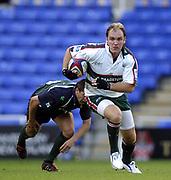 Reading, Berkshire, UK., 19th September 2004, Zurich Premiership Rugby, London Irish vs Leicester Tigers, Madejski Stadium, England,<br /> Leicester's fly half, Andy Goode, leaves Irish's Barry Everitt, sprawling