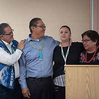 Steven Darden, left, Frankie Hoskie, left center, Nicole Atchley, right center, and Helen Waukazoo, right, stand together during Atchley's story. The Navajo Nation Alumni event in Window Rock on Apr. 26.