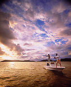 Two friends fish off a small boat in the carribean waters of British Virgin Islands