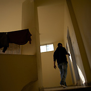Mostafa Haloum, a syrian refugee, walks by at a refugee center in Wadi Khaled, lebanon.