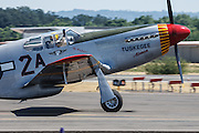 """The Commemorative Air Force's Redtail tribute P-51C Mustang, """"By Request"""" at the Oregon International Airshow."""