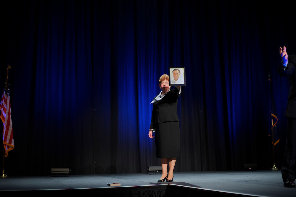 An autographed portrait of former Massachusetts Gov. Mitt Romney, a candidate for the Republican presidential nomination, is auctioned off during the Lancaster County GOP Annual Dinner at the Lancaster County Convention Center in Lancaster, Pa., on April 17, 2012.