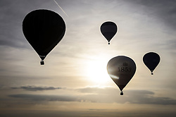 Balloons take flight from Clifton Downs, Bristol, as balloonists gather to mark less than a week to go until the start of the Bristol International Balloon Fiesta.