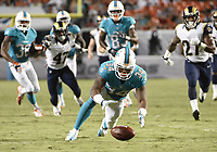 28 August 2014: Miami Dolphins running back Marcus Thigpen (34) recovers his own fumble against the St. Louis Rams in Miami s 14-13 victory at Sun Life Stadium, Miami, Florida. NFL American Football Herren USA AUG 28 Preseason - Rams at Dolphins PUBLICATIONxINxGERxSUIxAUTxHUNxRUSxSWExNORxONLY Icon211140828058<br /> <br /> 28 August 2014 Miami Dolphins Running Back Marcus Thigpen 34 recover His own Fumble Against The St Louis Rams in Miami s 14 13 Victory AT Sun Life Stage Miami Florida NFL American Football men USA Aug 28 Preseason Rams AT Dolphins PUBLICATIONxINxGERxSUIxAUTxHUNxRUSxSWExNORxONLY