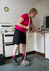© Licensed to London News Pictures. 07/09/2013<br /> <br /> Saltburn, Cleveland, England<br /> <br /> Lorna Smith begins the task of cleaning up her flat following a night of heavy flooding in Saltburn, Cleveland that brought chaos to the town.<br /> <br /> Photo credit : Ian Forsyth/LNP