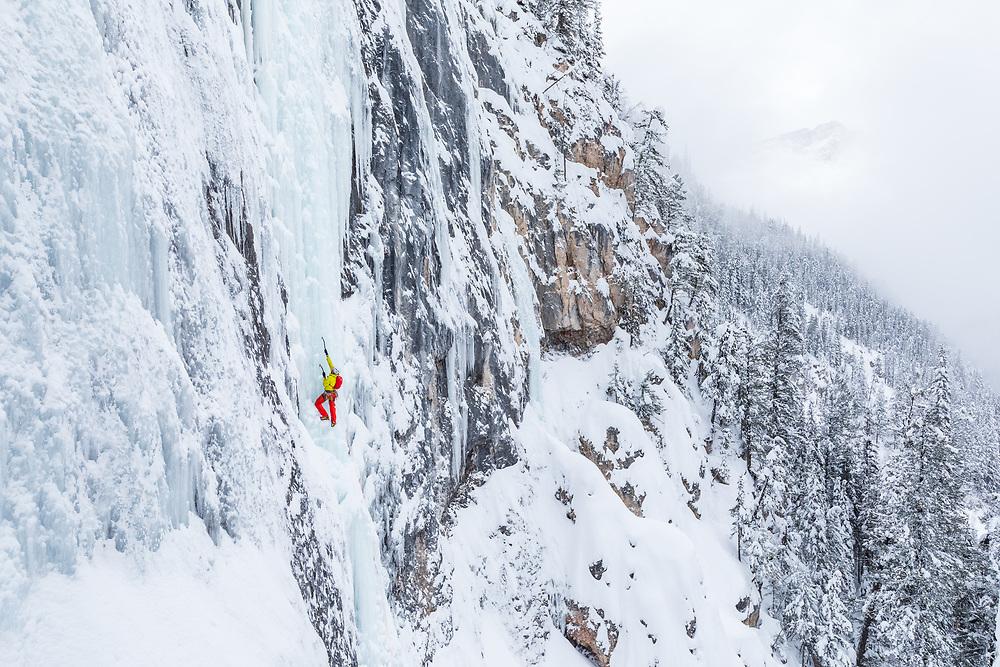 Patrick Lindsay climbing Iron Curtain WI5/6 along the Yoho Road in Field, BC, Canada