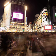 Shibuya crossing at night.