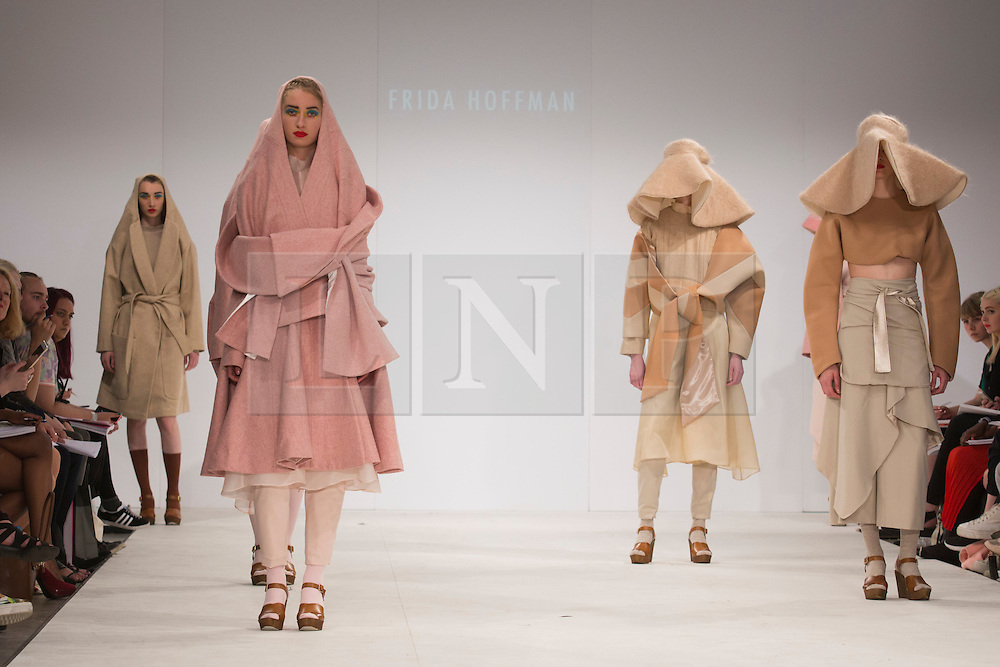 © Licensed to London News Pictures. 30/05/2015. London, UK. A model walks the runway during the Birmingham City University fashion show at Graduate Fashion Week 2015 wearing the collection of graduate student Frida Hoffman. Graduate Fashion Week takes place from 30 May to 2 June 2015 at the Old Truman Brewery, Brick Lane. Photo credit : Bettina Strenske/LNP