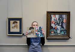 Pictured: Romey Clark from Bonham's auctioneers with two of the highlights of the sale, Joan Eardley's pastel 'girl eating a melon' estimated at £20-30,000 GBP and Samuel Peploe's 'Tulips in a chinese vase' estimated at £220-280,000 GBP.<br /> <br /> © Dave Johnston / EEm