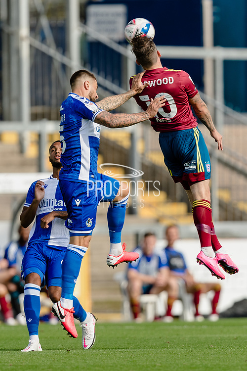 Bristol Rovers defender Max Ehmer (5) and Ipswich Town forward James Norwood (10) both go for the header during the EFL Sky Bet League 1 match between Bristol Rovers and Ipswich Town at the Memorial Stadium, Bristol, England on 19 September 2020.