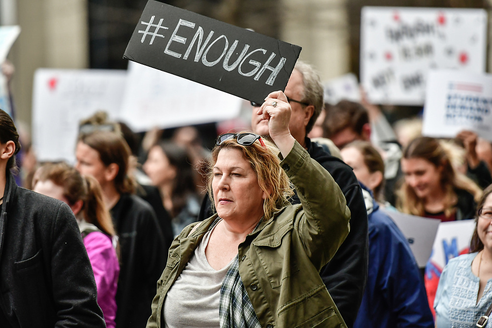 A woman holds up a sign as she marches during The March For Our Lives demonstration against gun violence in Nashville, TN on March 24, 2018